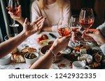 glasses of rose wine seen... | Shutterstock . vector #1242932335