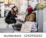 Young Woman Giving Money To...