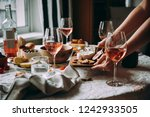 offering appetizers at a... | Shutterstock . vector #1242933505