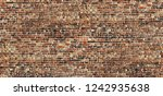 red brick wall background... | Shutterstock . vector #1242935638