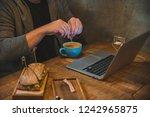 man hands working on laptop in... | Shutterstock . vector #1242965875