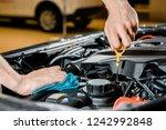 cropped shot of auto mechanic... | Shutterstock . vector #1242992848