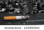 half smoked cigarette ... | Shutterstock . vector #124300342