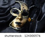 gold a carnival mask with black ... | Shutterstock . vector #124300576