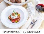 mozzarella and tomato salad | Shutterstock . vector #1243019665