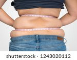 overweight woman with tape is...   Shutterstock . vector #1243020112