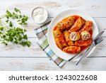 cabbage rolls stuffed with... | Shutterstock . vector #1243022608
