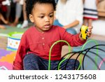 little boy playing toys in the... | Shutterstock . vector #1243175608