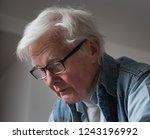 elderly man with glasses is...   Shutterstock . vector #1243196992
