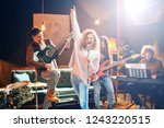 jazz band preparing for the gig.... | Shutterstock . vector #1243220515