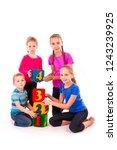 happy kids holding blocks with... | Shutterstock . vector #1243239925