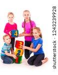 happy kids holding blocks with... | Shutterstock . vector #1243239928