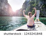 girl on a boat in a lagoon in... | Shutterstock . vector #1243241848