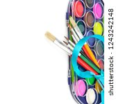 watercolor paints and brushes... | Shutterstock . vector #1243242148