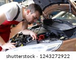 job and workplace   mechanic in ... | Shutterstock . vector #1243272922