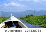 canoe on a river in a gorgeous landscape in the shan state of Myanmar - stock photo