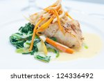 Small photo of grilled snapper with sauteed vegetables and a creamy fish sauce