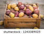 fresh raw potatoes in the crate  | Shutterstock . vector #1243389025