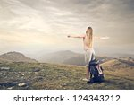 blonde girl opening her arm on... | Shutterstock . vector #124343212