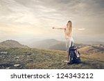 blonde girl opening her arm on... | Shutterstock . vector #124343212