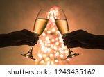couples hands making toast next ... | Shutterstock . vector #1243435162