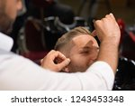 professional barber in white... | Shutterstock . vector #1243453348