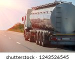 big gas tank goes on highway... | Shutterstock . vector #1243526545