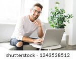 a young attractive guy is...   Shutterstock . vector #1243538512