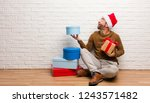 young crazy man celebrating... | Shutterstock . vector #1243571482