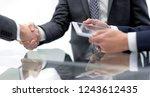 close up.handshake of new... | Shutterstock . vector #1243612435