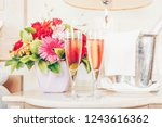 two glasses of rose champagne... | Shutterstock . vector #1243616362