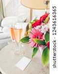 two glasses of rose champagne... | Shutterstock . vector #1243616365