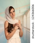 Beautiful young woman in wedding gown, portrait in arabic style - stock photo