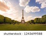 the eiffel tower in daylight... | Shutterstock . vector #1243699588