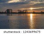 scenic sunrise over the river... | Shutterstock . vector #1243699675