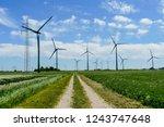 wind turbines in the field  in...   Shutterstock . vector #1243747648