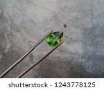 beautiful natural peridot... | Shutterstock . vector #1243778125