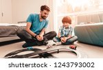 bearded father and son playing... | Shutterstock . vector #1243793002