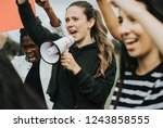 group of female activists is... | Shutterstock . vector #1243858555