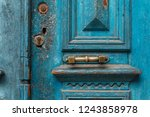 Blue Wooden Old Door In A Red...