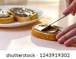 spread chocolate paste on... | Shutterstock . vector #1243919302