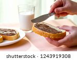 spread chocolate paste on... | Shutterstock . vector #1243919308