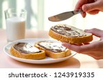 spread chocolate paste on... | Shutterstock . vector #1243919335