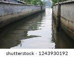 lake waterway peacefully... | Shutterstock . vector #1243930192