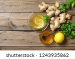 ginger tea with lemon in glass... | Shutterstock . vector #1243935862