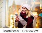 happy smiling hipster girl... | Shutterstock . vector #1243952995