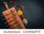 raw kebab with spices on a... | Shutterstock . vector #1243966975