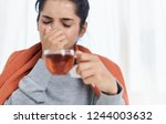 ailing woman with a cup of tea  ... | Shutterstock . vector #1244003632