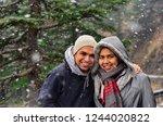 young indian couple enjoying... | Shutterstock . vector #1244020822