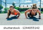 two young sportswomen doing... | Shutterstock . vector #1244055142